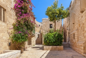 Narrow cobbled street among typical houses of Jewish Quarter in Old City of Jerusalem, Israel.