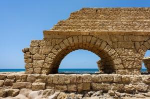 Ancient Roman aqueduct in Ceasarea at the coast of the Mediterranean Sea, Israel built by Herod, Israel